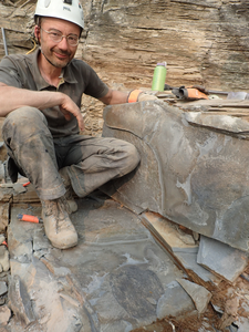 Jean-Bernard Caron with fossil of Titanokorys gainesi at the quarry site