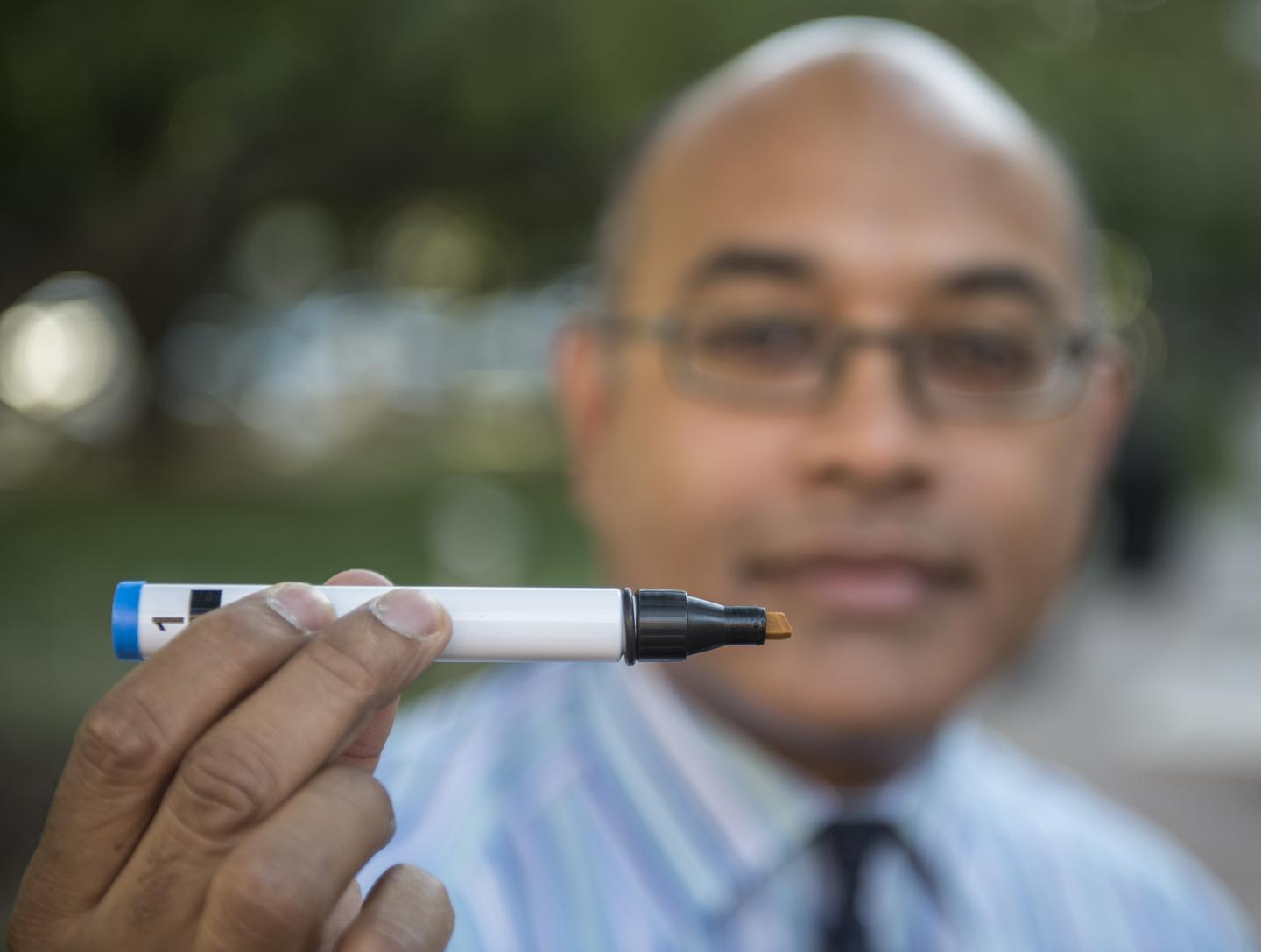 Jayant Pinot, MD, with Research Tool
