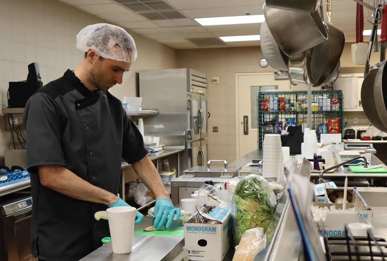 NIDDK Metabolic Kitchen 2019 -- An Employee Chops Chicken in a Hospital Kitchen