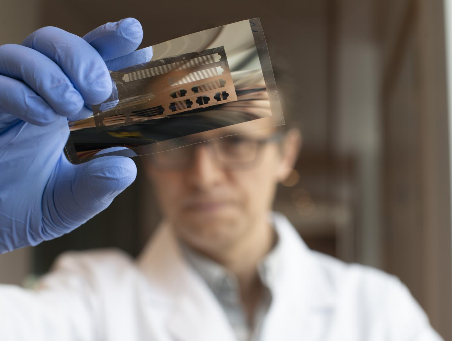 Dr Ross Hatton Examining a Patterned Metal
