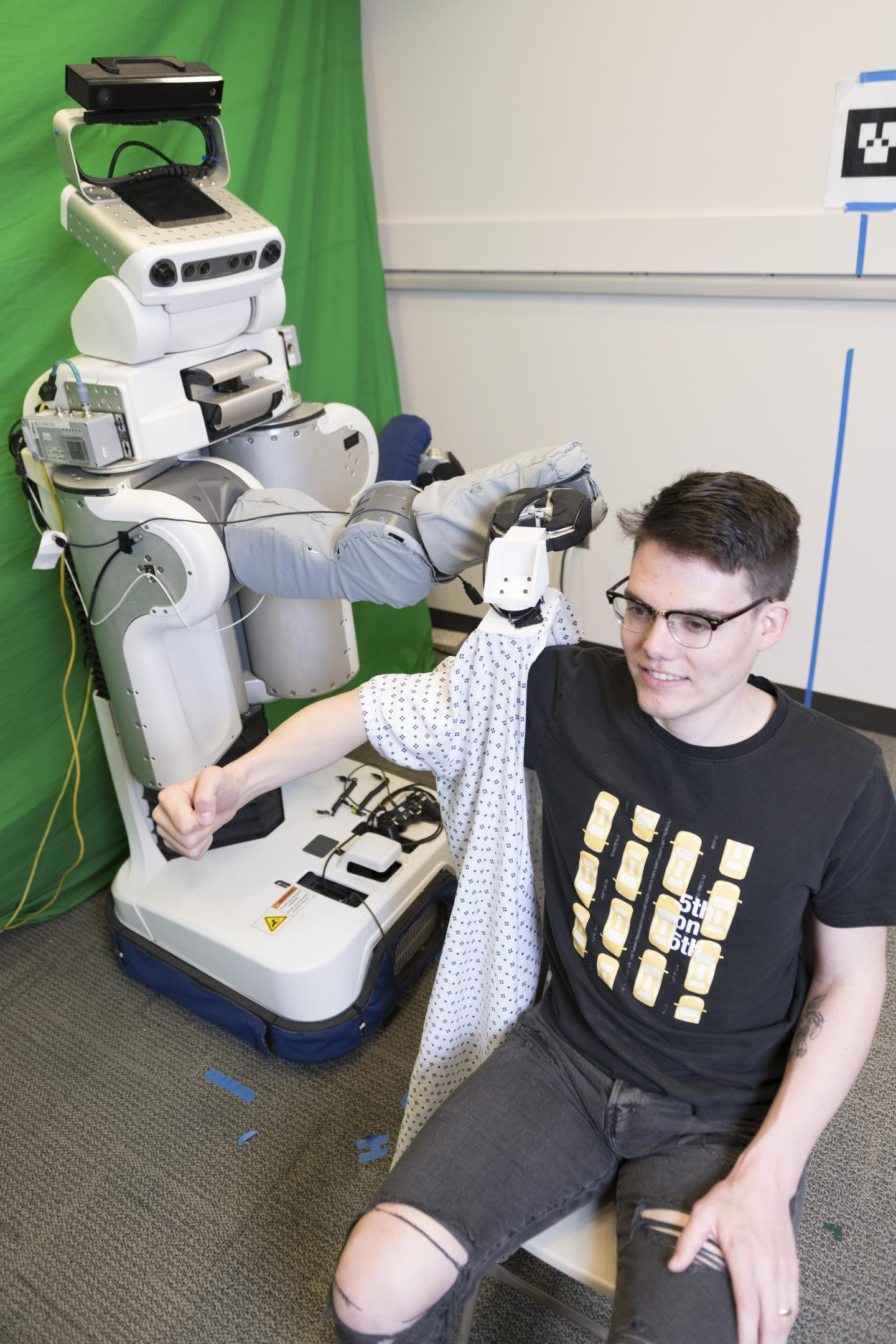 Robot Dresses Human