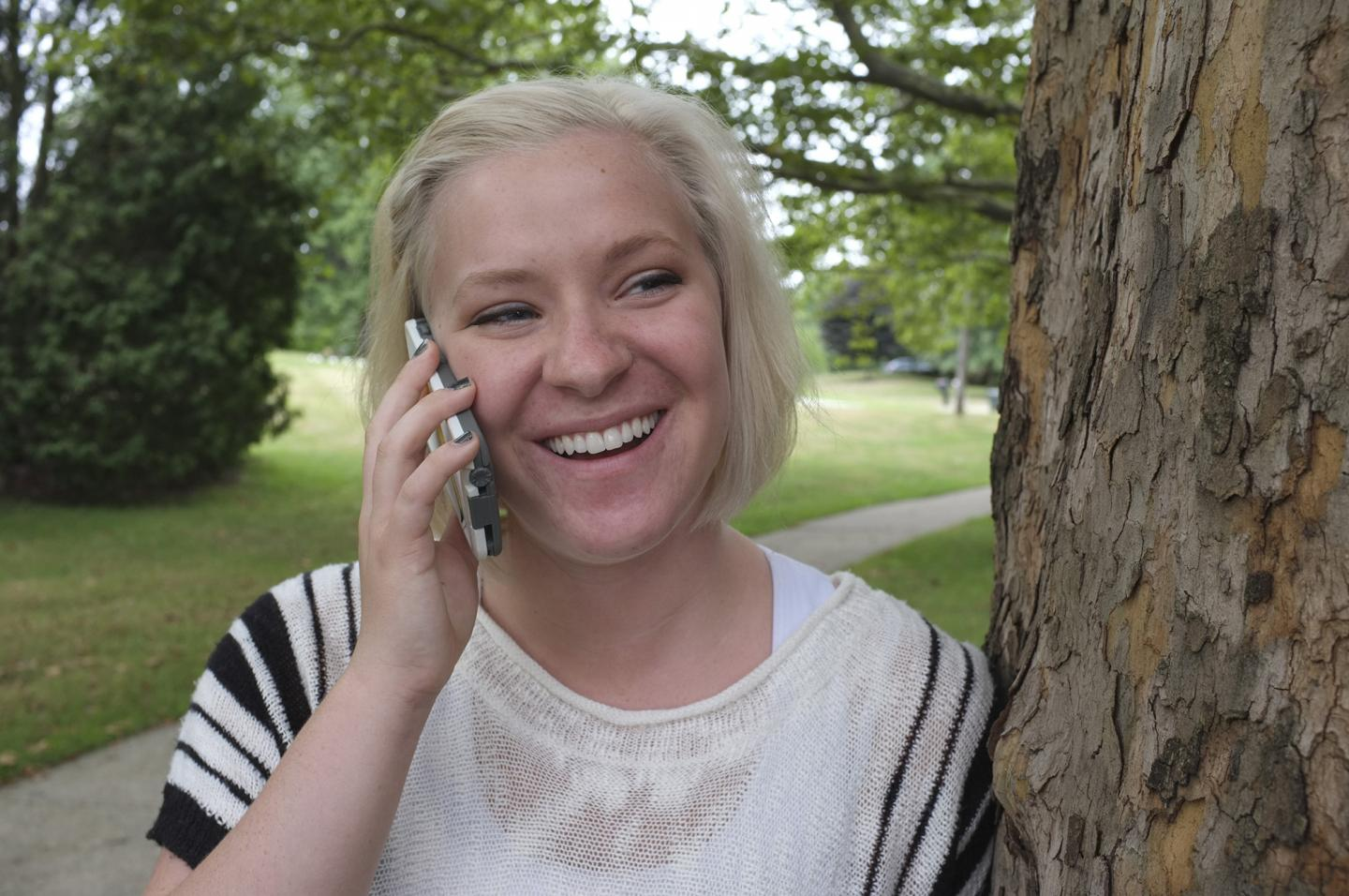 Kent State University Student Talks with Her Parents on Her Cell Phone