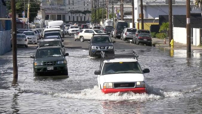 Vehicles on flooded roadway