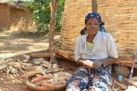 Female Farmer With Cobs Of Maize