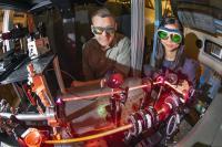 Sandia National Laboratories engineers observe a laser .