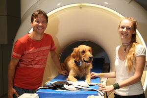 Trained dog with researchers at fMRI