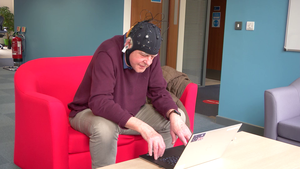 A volunteer takes part in the Fastball EEG test