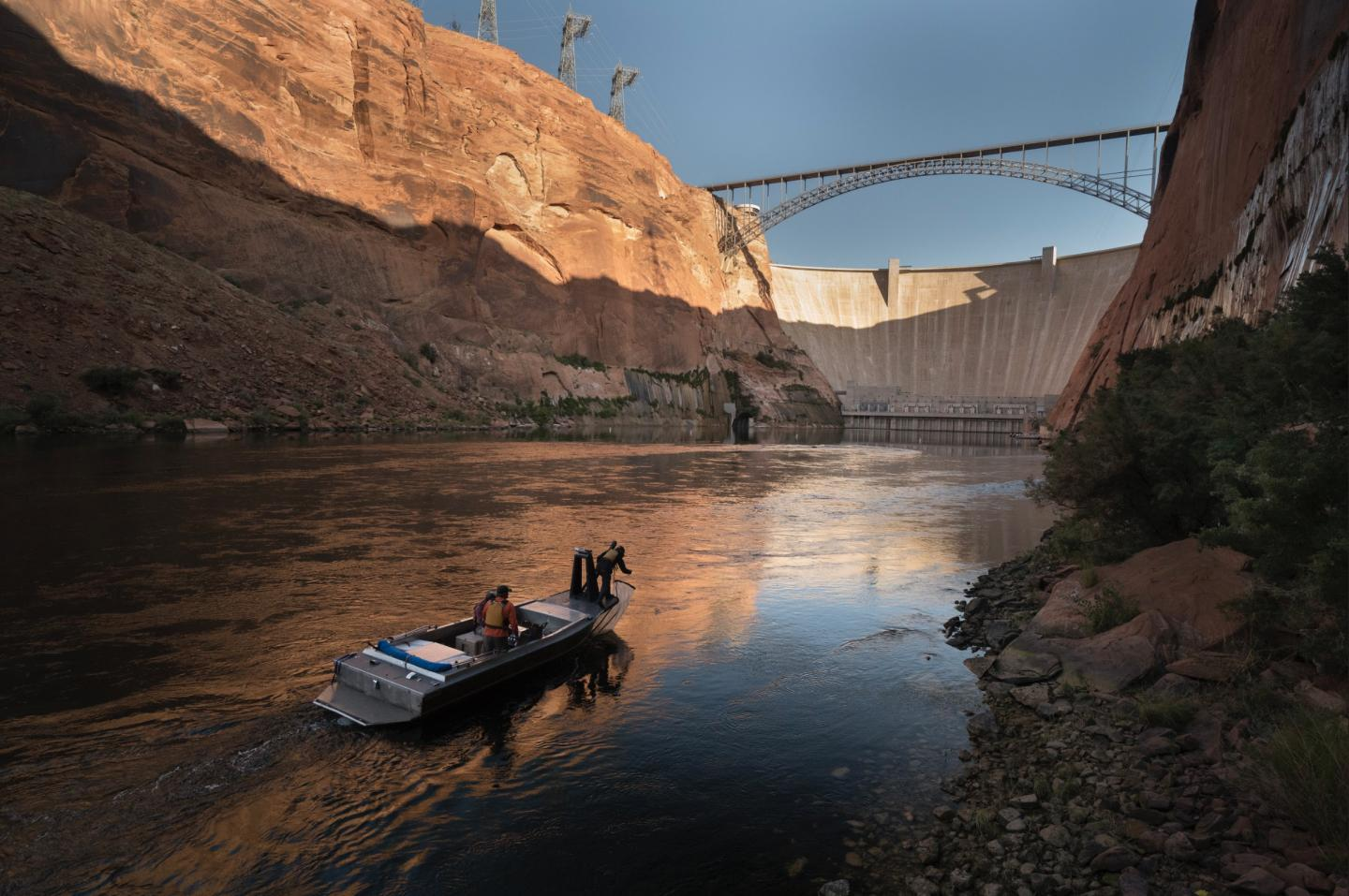 Researchers in Boat in Front of Dam
