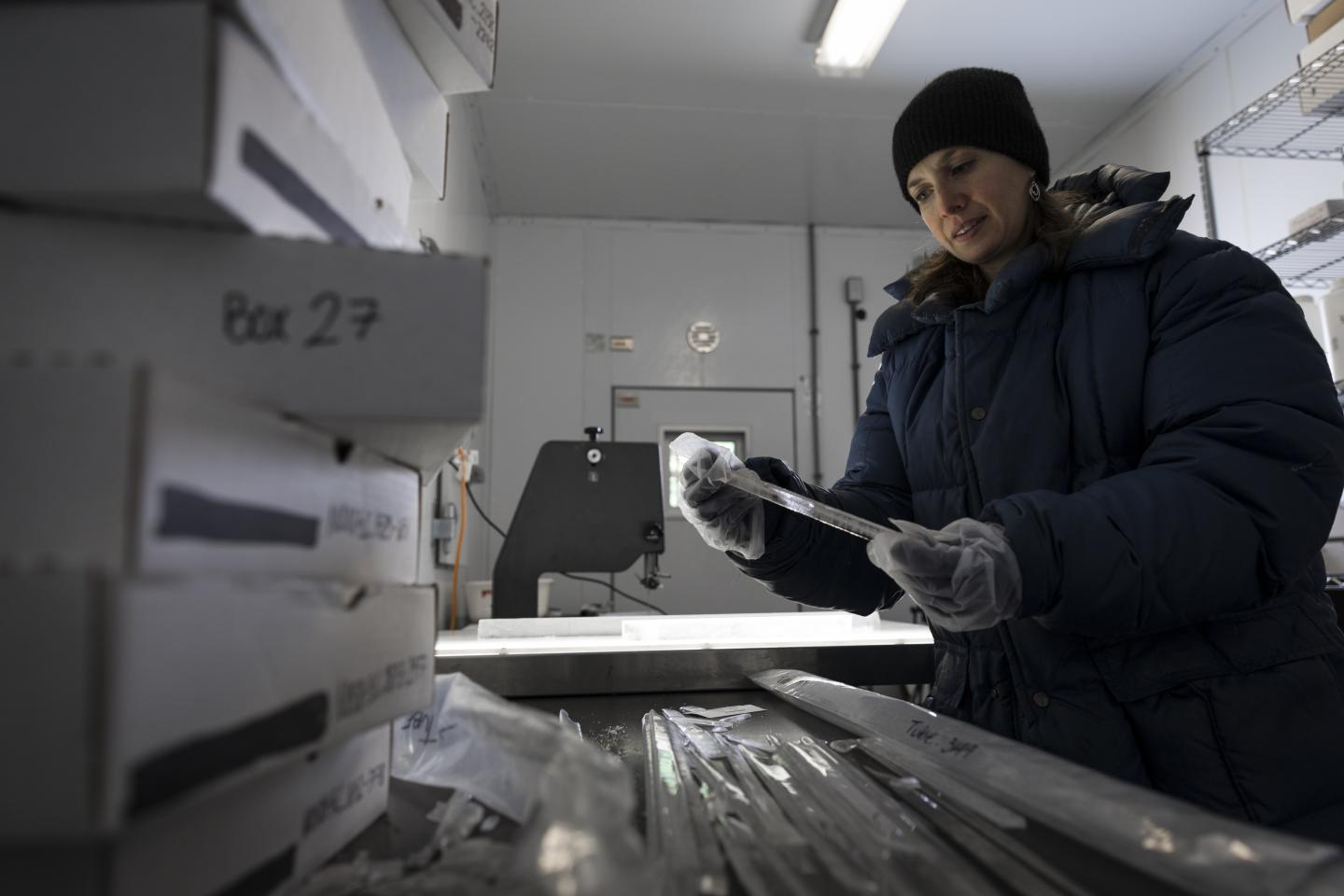 Researcher with Ice Core
