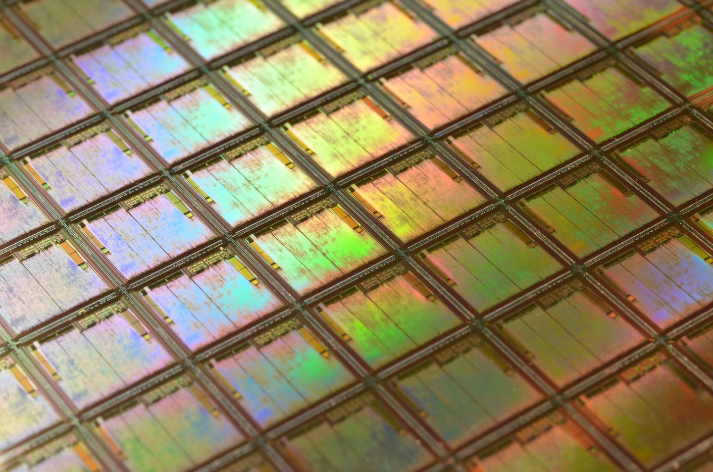 Wafer-scale production of graphene-based photonic devices