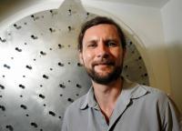 Michael Hart with Prototype of Adaptive Mirror