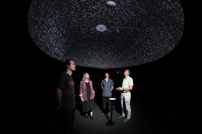 Under a dome showing the virtual universe