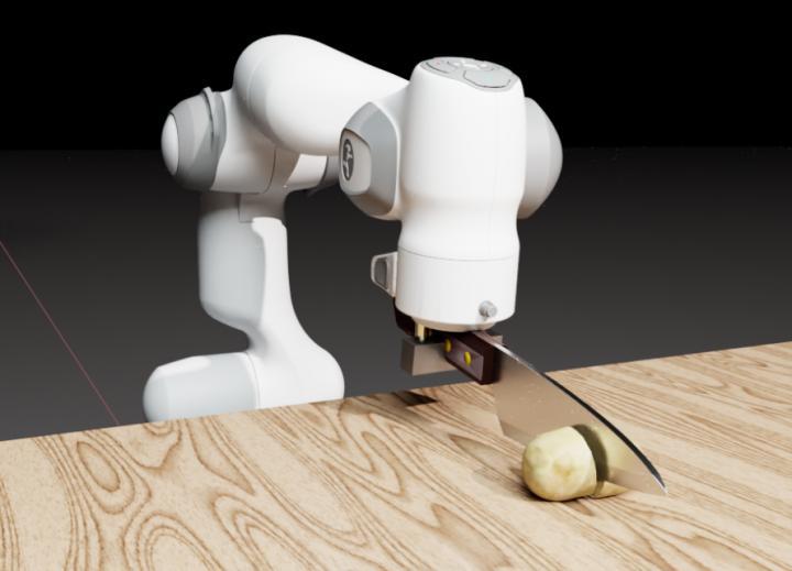 Panda robot cutting potato