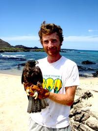 Noah Whiteman with a Galápagos Hawk