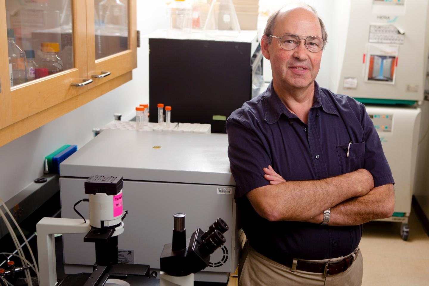 Michael Russell, PhD, standing in lab