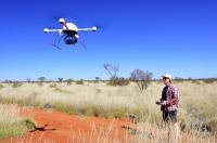 Researcher in Field Flying Microdrone