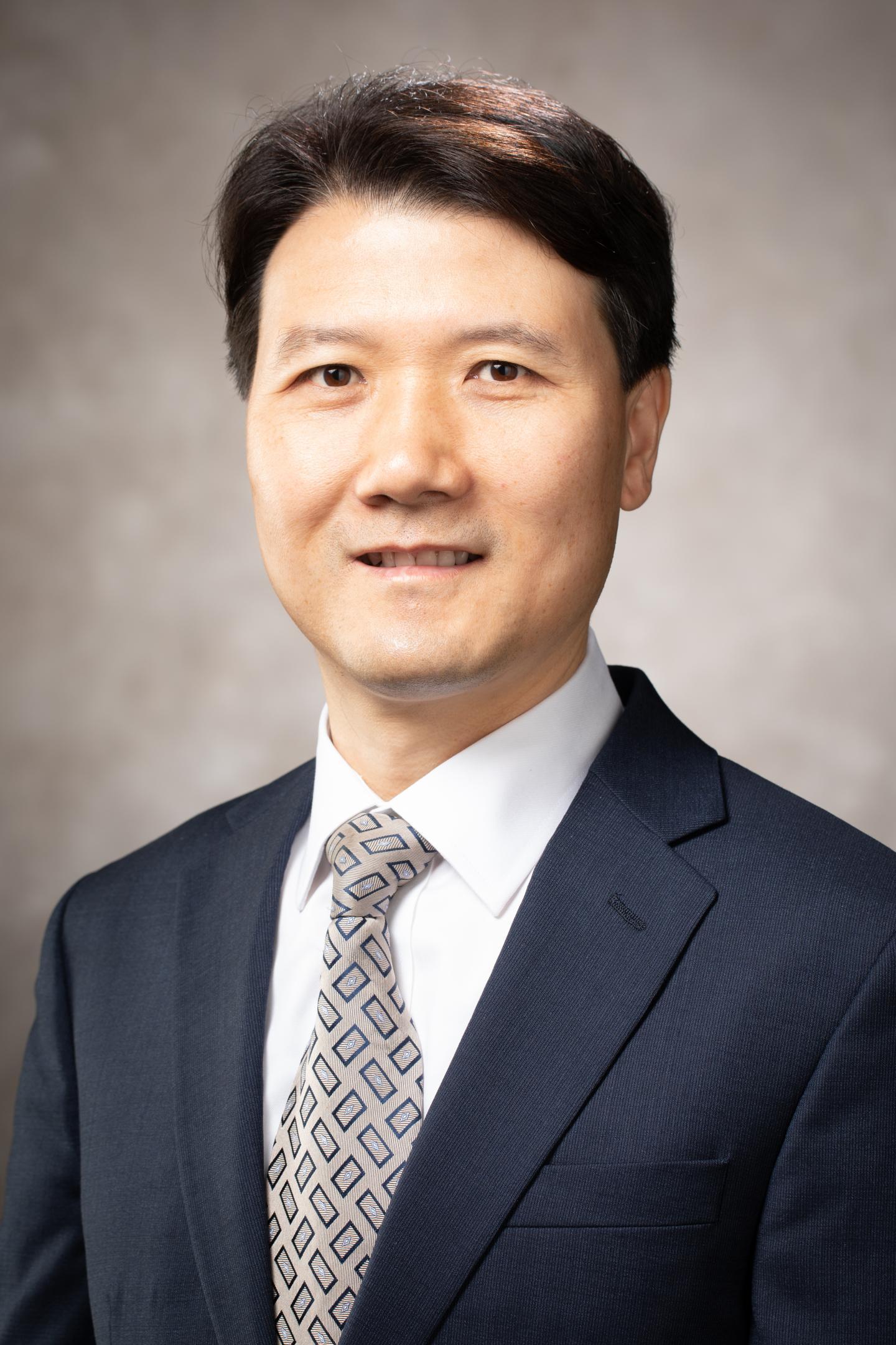 Justin Zhan University of Arkansas