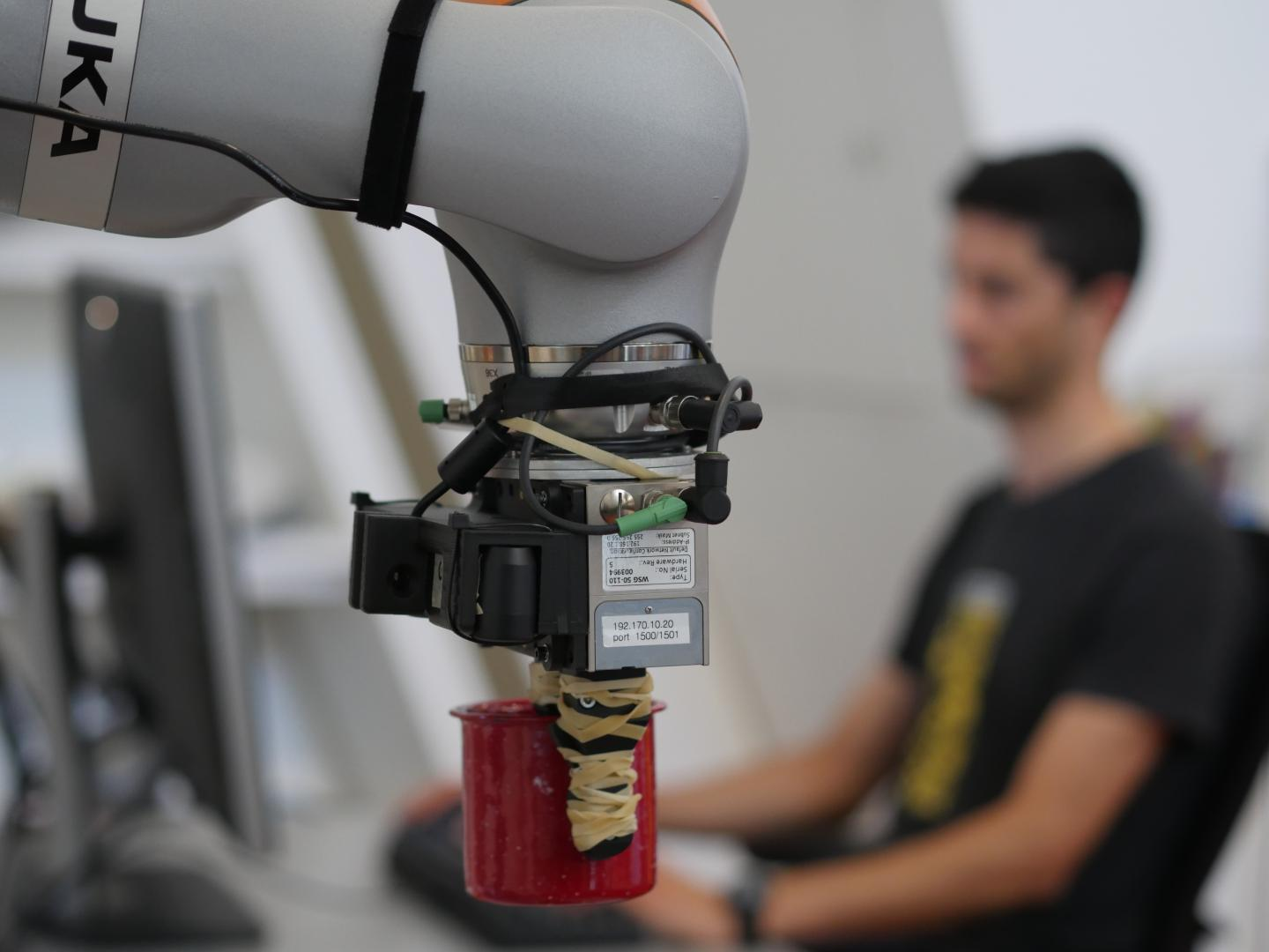 Lucas Manuelli With Robot and System