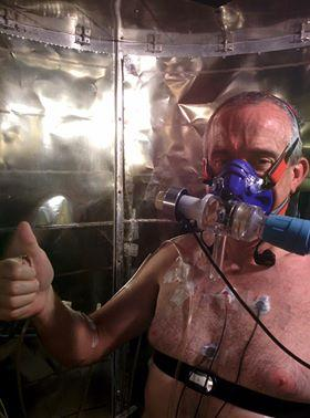 Participant seated within the calorimeter, which measures how much heat his body is losing.
