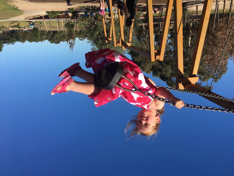 Sarah, who has achoondroplasia, enjoys the local swings