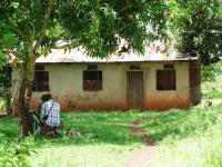 Innovations for Poverty Action Field Researcher talking with a Ugandan landowner