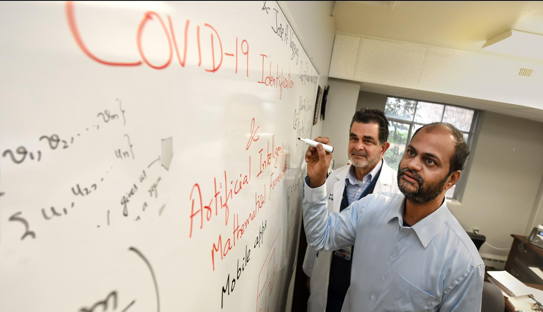 Drs. Arni Rao (foreground) and Jose Vazquez