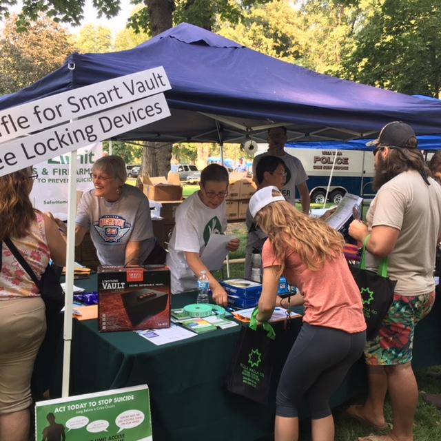 Volunteers talking about firearm safety, suicide prevention at community event