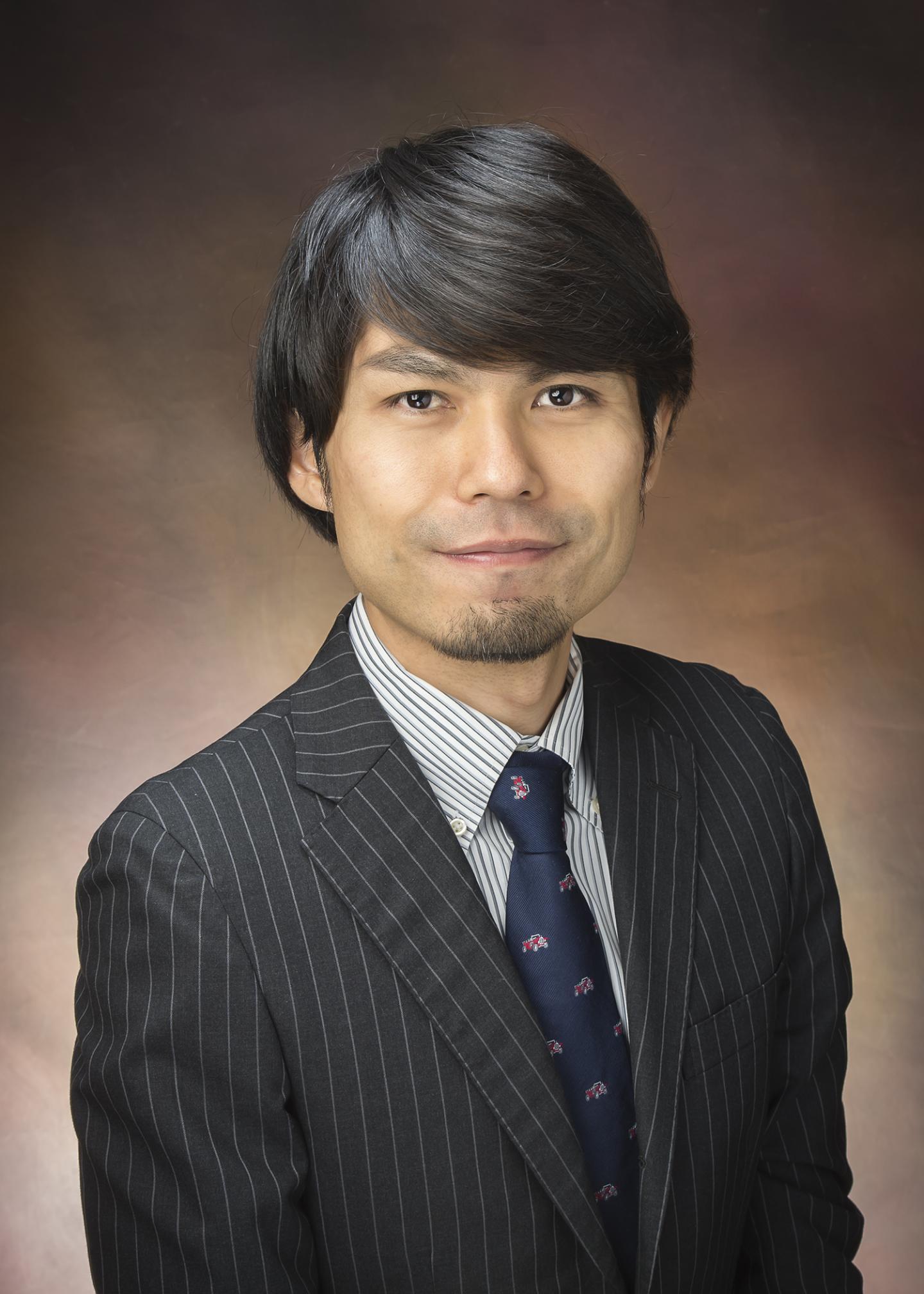 Dr. Kosuke Izumi