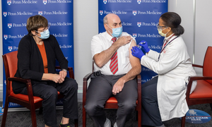 Katalin Karikó and Drew Weissman receiving a dose of the COVID-19 vaccine they helped to create