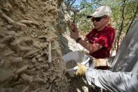 Researchers collecting bulk sediment samples